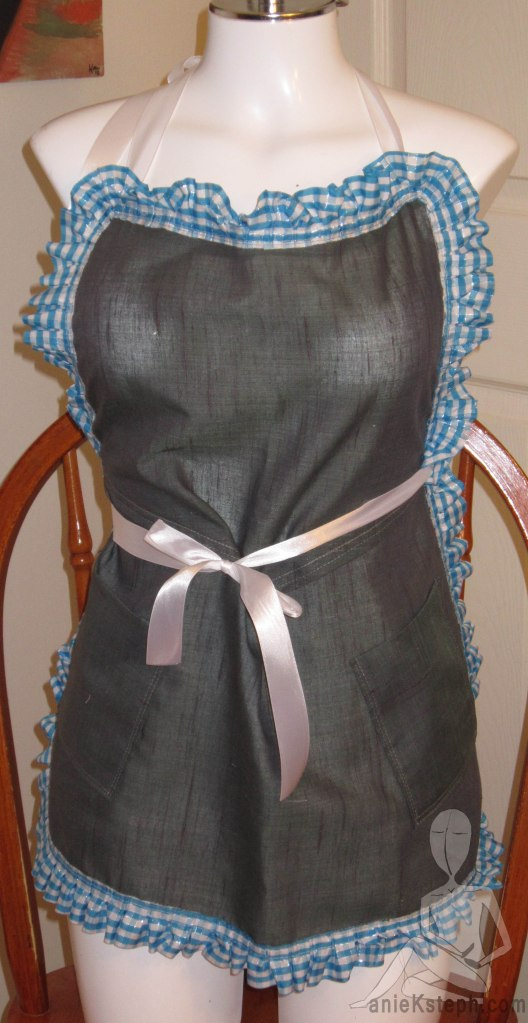 Dorothy Apron- A Blue Gingham-frilled border on a sheer hemp bodice. Finished with a white satin ribbon