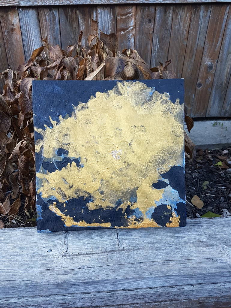 A shapeless Gold acrylic and gold leaf over top a black negative spac