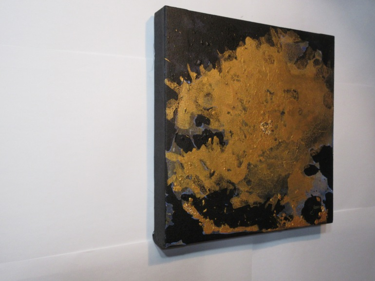 A shapeless Gold acrylic and gold leaf over top a black negative space