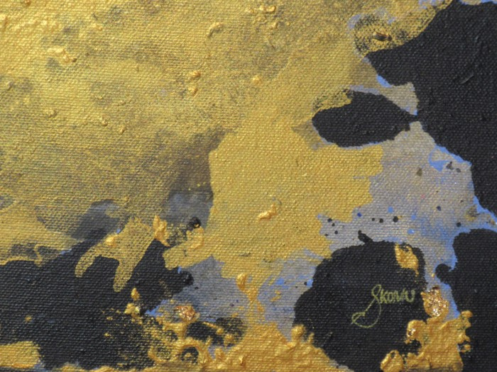 A shapeless Gold acrylic and gold leaf over top a black negative space zoomed in to see artist signature