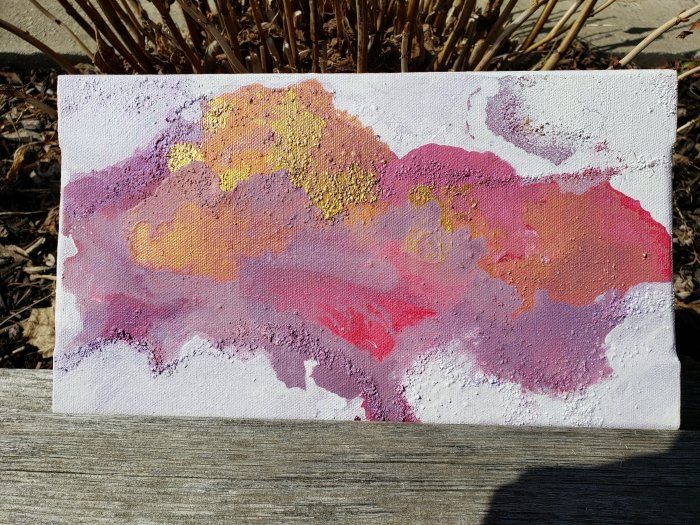 Pink, magenta, gold inkblot bright colour with white negative space