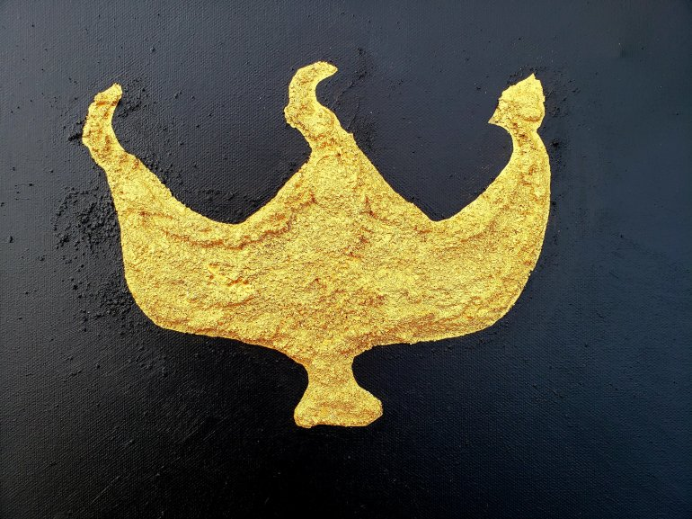 Gold trident shape symbol with black background