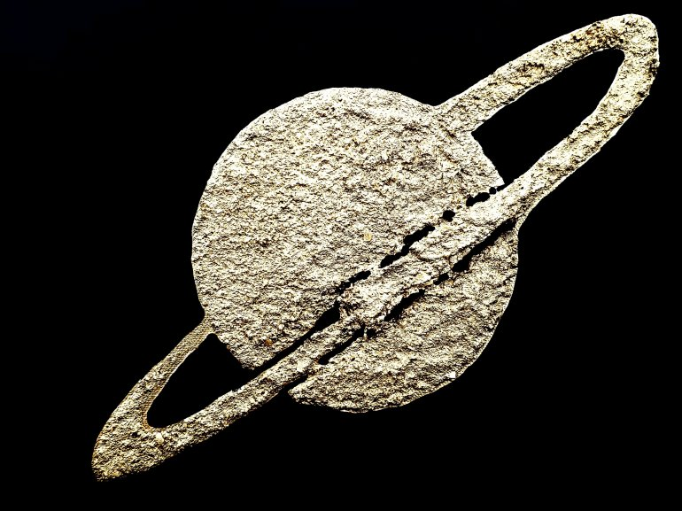 An acrylic texture relief painting Epsilon in gold texture with black background Saturn ring planet