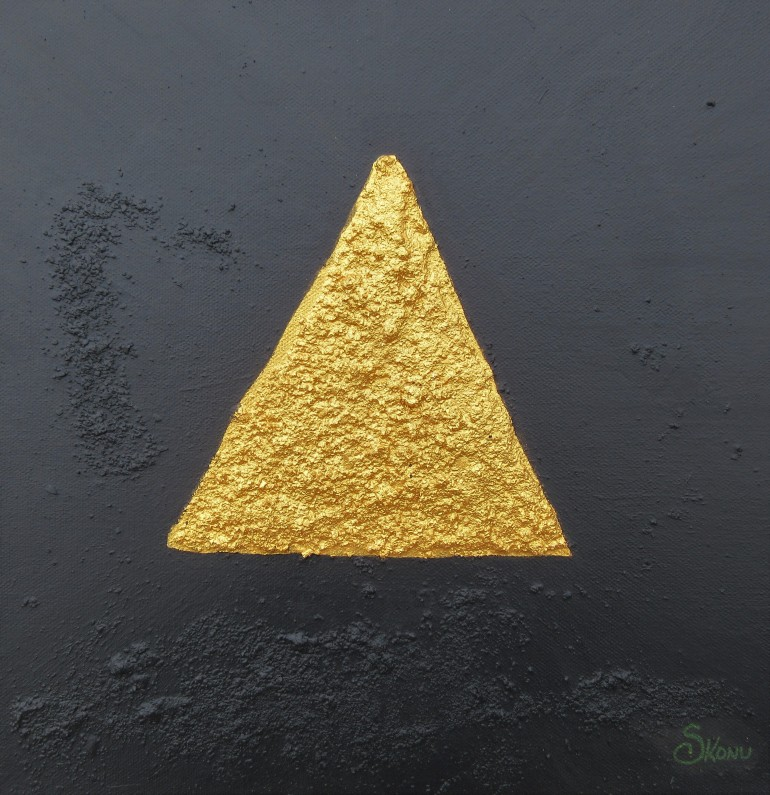 Gold triangle against black acrylic