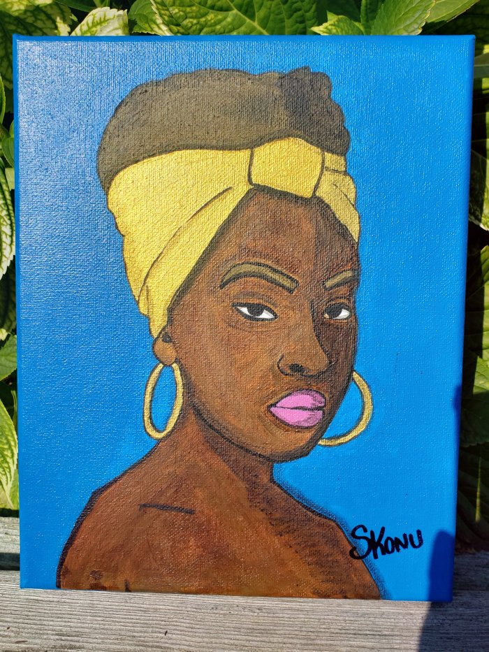 African woman with gold accent and blue background  acrylic on canvas by Stephanie Konu
