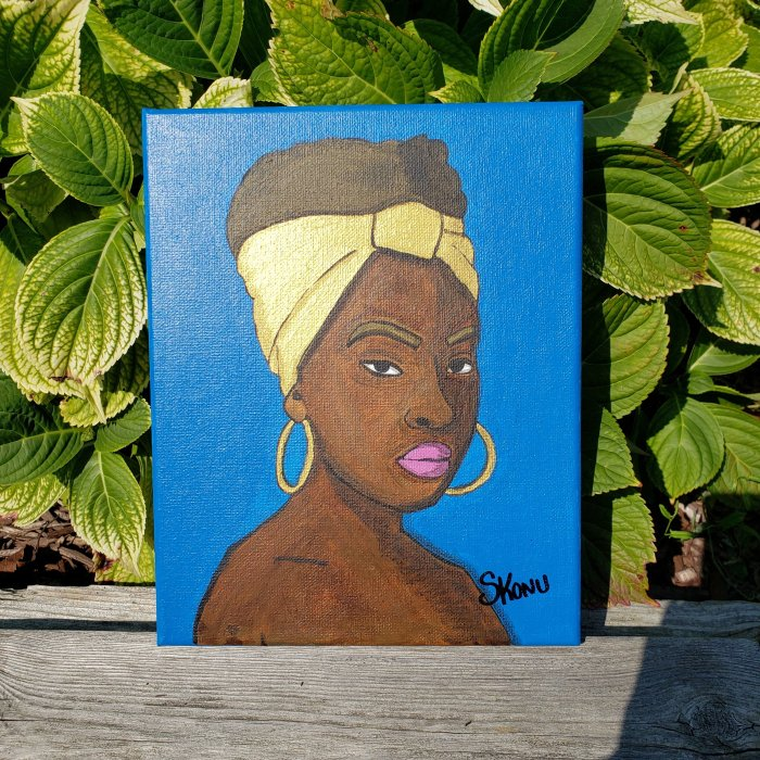 African woman with blue background and gold Accent acrylic on canvas by Stephanie Konu